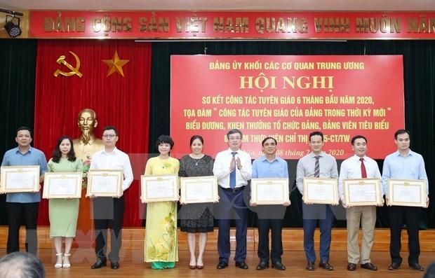 Analizan labores de propaganda partidista de los organos centrales de Vietnam hinh anh 1