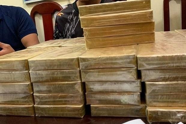 Capturan en Vietnam a tres narcotraficantes y decenas de bloques de heroina hinh anh 1