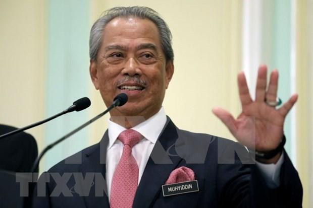 Primer ministro malasio gana pruebas de apoyo en Camara Baja hinh anh 1
