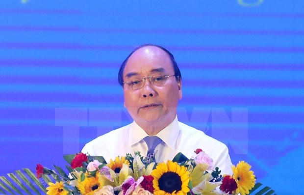 Premier vietnamita insta a perfeccionar politicas para jovenes voluntarios de guerra hinh anh 1