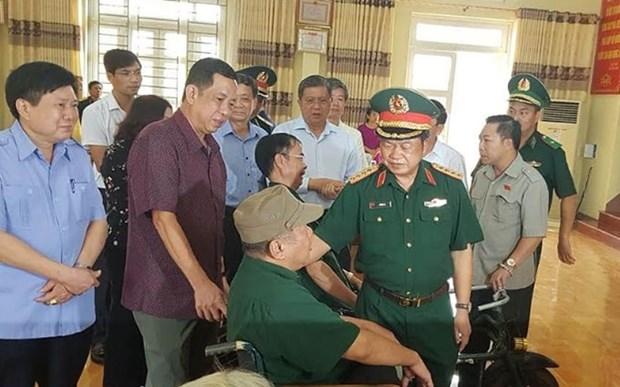 Resaltan aportes de personas con meritos revolucionarios en provincia vietnamita hinh anh 1