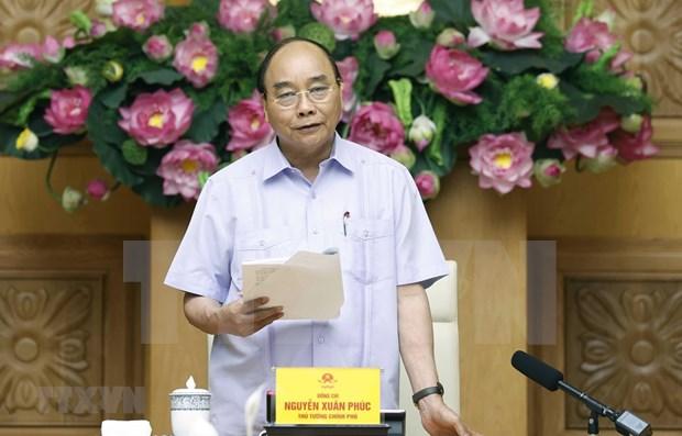 Insta premier de Vietnam a acelerar reformas crediticias para revetir impactos de COVID-19 hinh anh 1