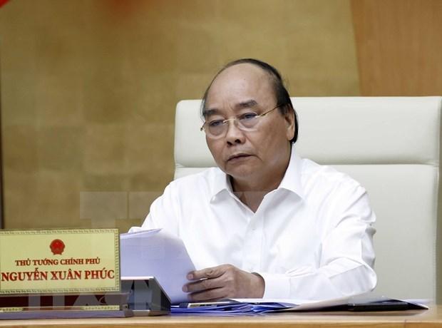 Premier de Vietnam exige mantener en alto la vigilancia ante compleja evolucion del COVID-19 hinh anh 1