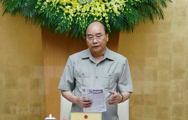 Premier vietnamita aboga el pueblo por intensificar lucha contra COVID-19 hinh anh 1