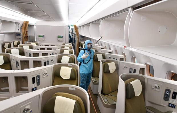 Vietnam Airlines aplica medidas mas estrictas de prevencion del COVID-19 hinh anh 1