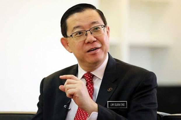 Arrestan a exministro malasio por acusacion de corrupcion hinh anh 1