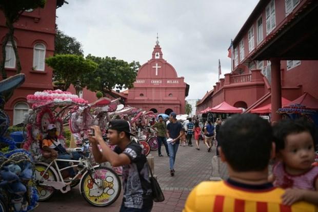 Turismo domestico de Malasia aumenta por flexibilizacion de medidas contra COVID-19 hinh anh 1