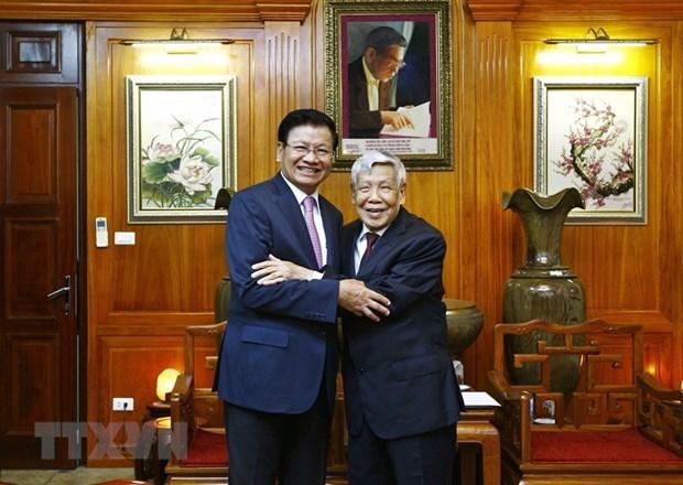 Resaltan aportes del exmaximo dirigente partidista de Vietnam Le Kha Phieu a lazos con Laos hinh anh 1