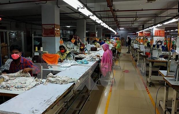 Millones de trabajadores textiles en el sur y Sudeste Asiatico se ven afectados por el COVID-19 hinh anh 1
