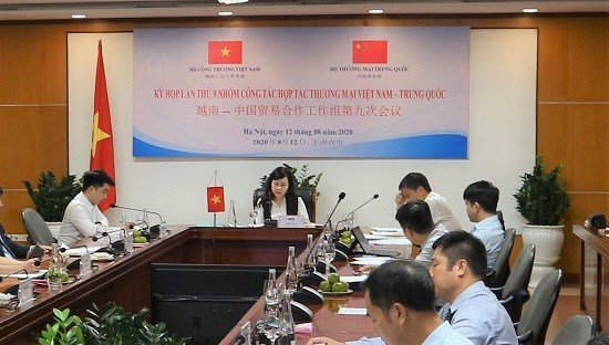 Debaten medidas para impulsar cooperacion comercial Vietnam-China hinh anh 1