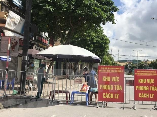 Hanoi localiza y desinfecta zona de nuevo paciente del COVID-19 hinh anh 1