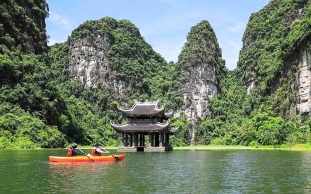 Travesia en kayak para contemplar la magnifica naturaleza de Trang An hinh anh 1