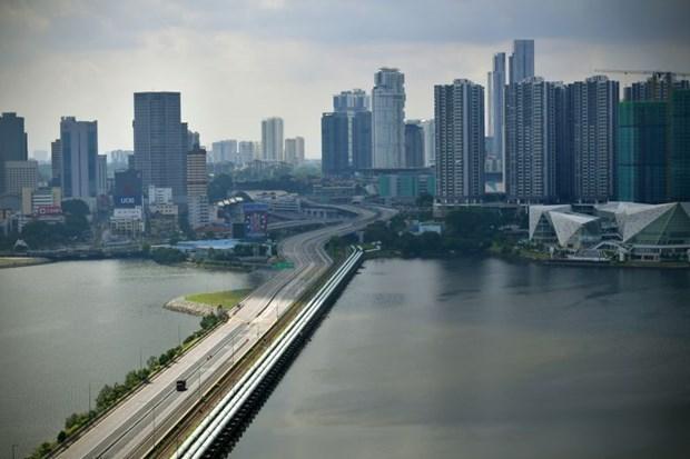 Malasia y Singapur reabren oficialmente la frontera entre ambos paises hinh anh 1