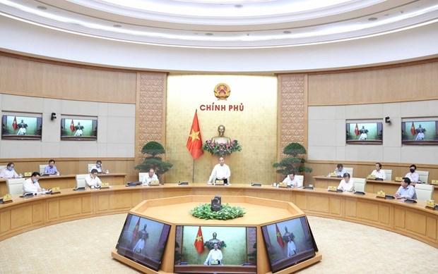 Premier vietnamita insta a centrar esfuerzos para la recuperacion economica hinh anh 1