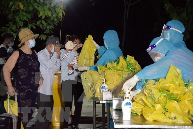 Repatrian a ciudadanos vietnamitas varados en Macao de China hinh anh 1