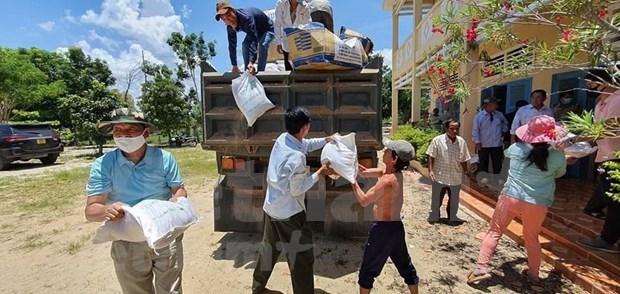 Vietnamitas respaldan a compatriotas en Camboya en el enfrentamiento al COVID-19 hinh anh 1