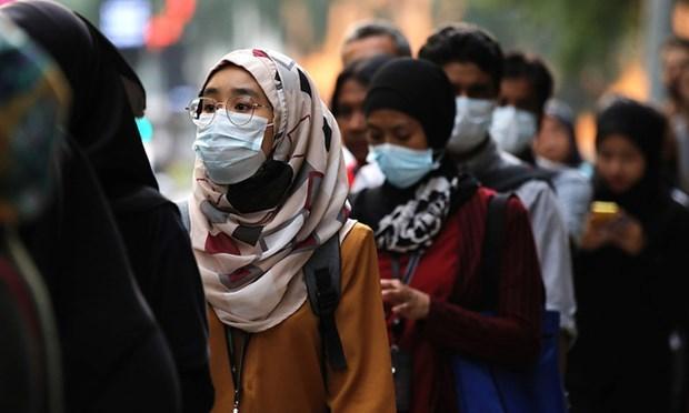 Malasia prohibe la entrada a ciudadanos de paises con rebrote epidemico hinh anh 1