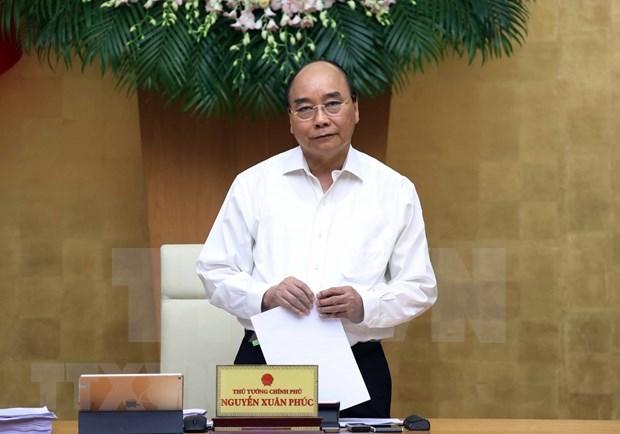 Primer ministro de Vietnam insta a lograr crecimiento economico alto en medio del COVID-19 hinh anh 1