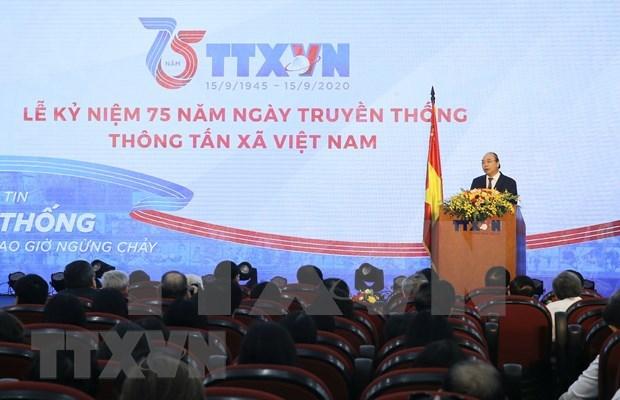 Premier vietnamita urge a VNA a mantener su posicion como centro de informacion confiable del Partido y Estado hinh anh 1
