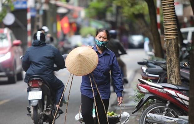 Vietnam pierde 2,4 millones de empleos debido al COVID-19 hinh anh 1