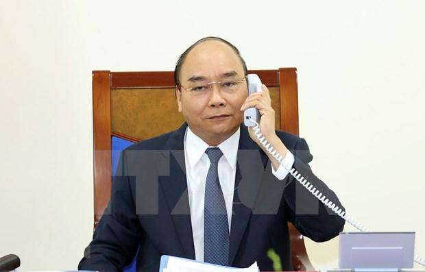 Premier vietnamita conversa por telefono con Angela Merkel sobre lazos bilaterales hinh anh 1