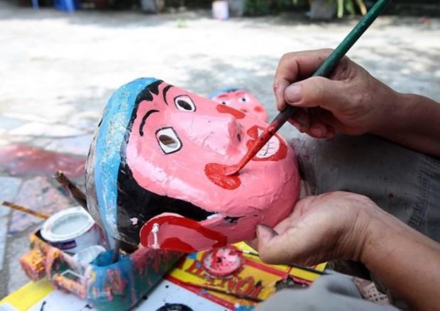 Talleres con artesanos de juguetes tradicionales, entre actividades de Fiesta de Medio Otono en Vietnam hinh anh 1