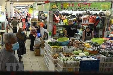 Mercado laboral en Singapur con datos negativos hinh anh 1