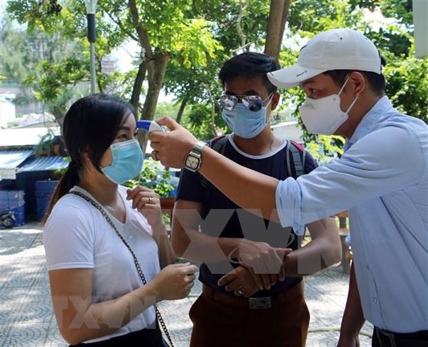 Primer ministro de Vietnam insta a continuar aplicando estrictamente medidas contra el COVID-19 hinh anh 1