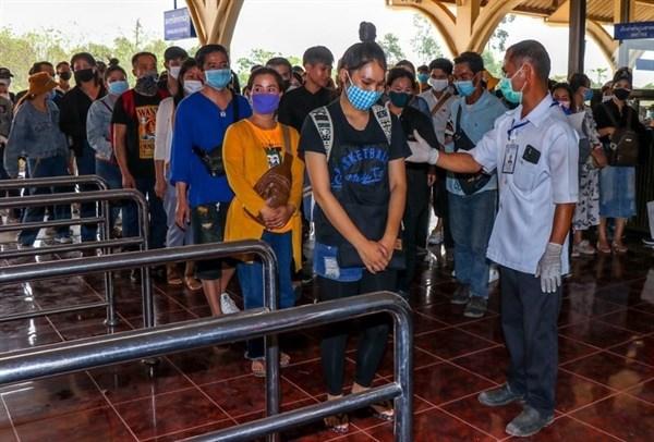 Laos exhorta a su poblacion a continuar observando medidas preventivas del COVID-19 hinh anh 1
