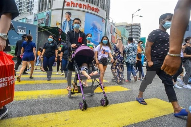 Malasia registra mayor numero de nuevos casos diarios del COVID-19 hinh anh 1