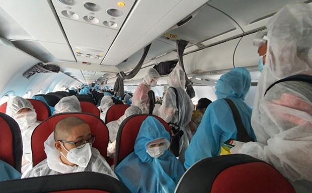 COVID-19: Regresan a casa ciudadanos vietnamitas varados en Japon y Myanmar hinh anh 1