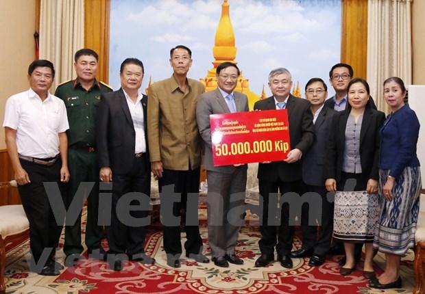 Apoyan vietnamitas mitigacion de consecuencias de inundaciones en Laos hinh anh 1