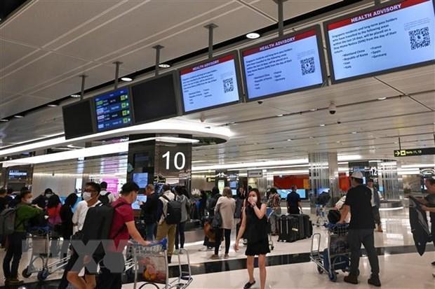 Singapur permite llegadas de los viajeros de China y el estado australiano de Victoria hinh anh 1