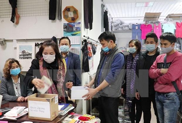 Vietnamitas dentro y fuera del pais respaldan a connacionales afectados por inundaciones hinh anh 1