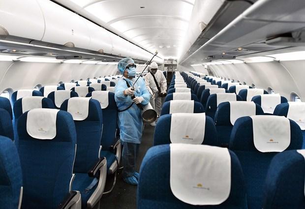 Vietnam Airlines realiza desinfecciones estrictas, especialmente en aviones de vuelos internacionales hinh anh 1
