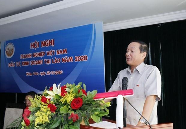 Debaten medidas para estimular operaciones de empresas vietnamitas en Laos hinh anh 1