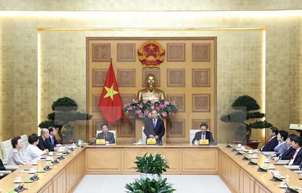 Premier vietnamita destaca aporte de empresas a la economia nacional hinh anh 1
