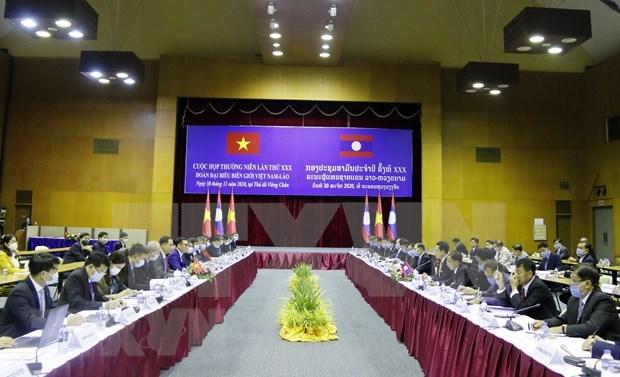 Vietnam y Laos buscan facilitar circulacion de mercancias en frontera terrestre comun hinh anh 1
