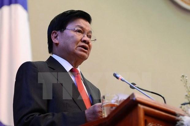 Realizara primer ministro de Laos visita a Vietnam hinh anh 1