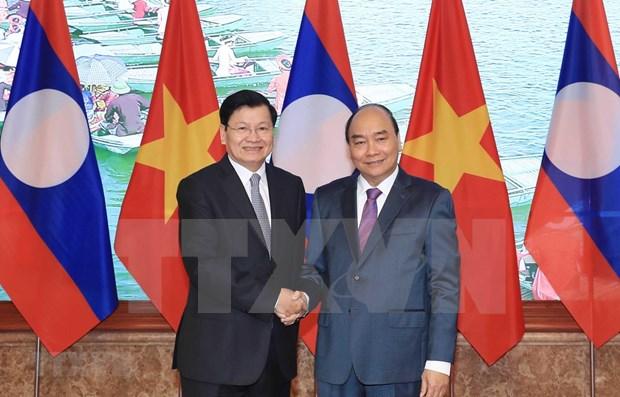 Vietnam y Laos decididos a fomentar la cooperacion integral hinh anh 1