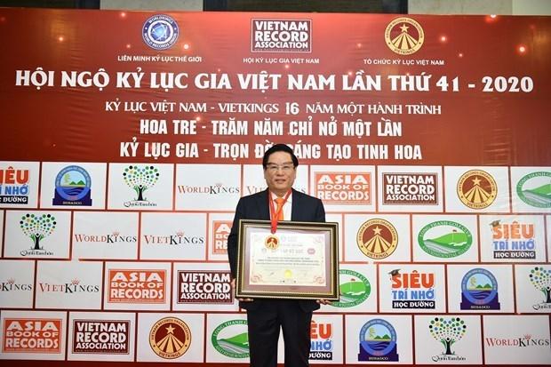 Ceremonia de izamiento de bandera de empresa vietnamita establece record hinh anh 3