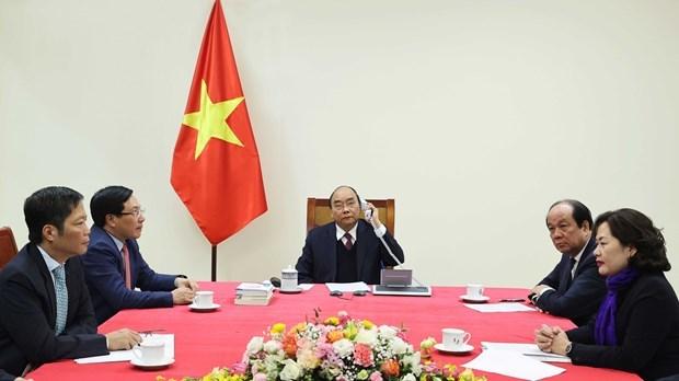 Primer ministro de Vietnam sostiene conversacion telefonica con presidente estadounidense Donald Trump hinh anh 2