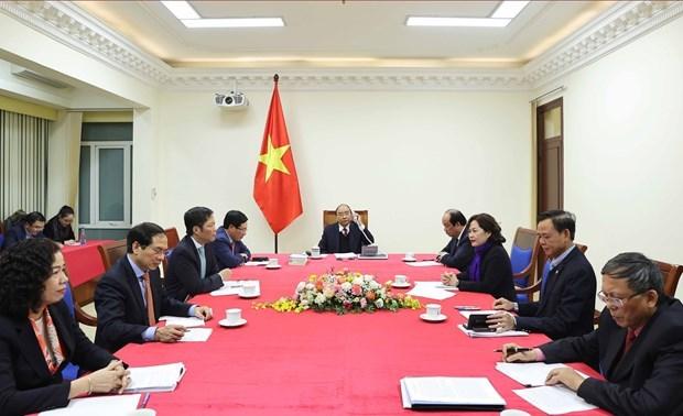 Primer ministro de Vietnam sostiene conversacion telefonica con presidente estadounidense Donald Trump hinh anh 3