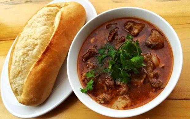 Pan con salsa de vino, especialidad de gastronomia de Hanoi hinh anh 1