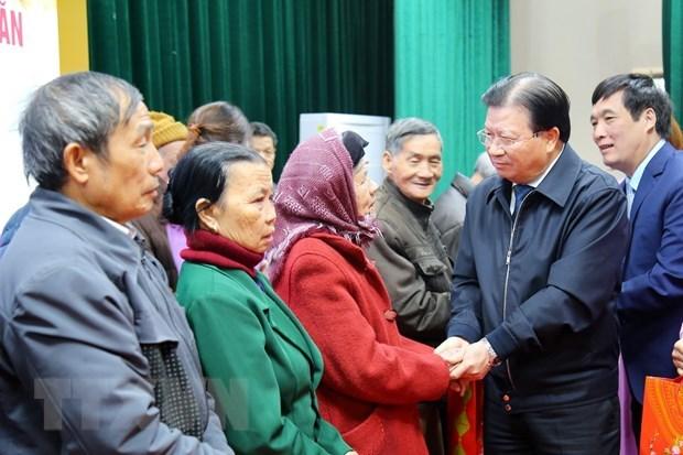Mejorar la vida de la poblacion es la gran politica de Vietnam, reafirma vicepremier hinh anh 1