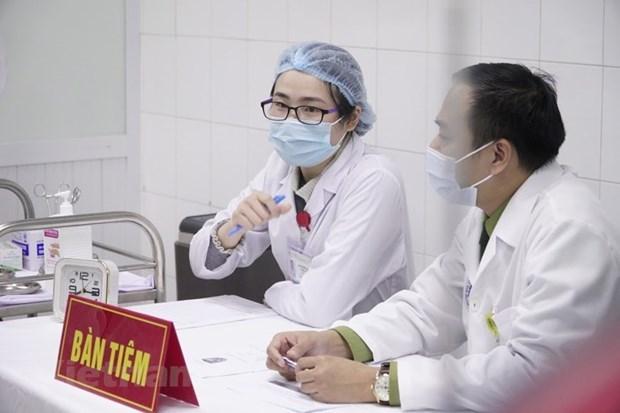 Continua adelante en Vietnam segunda inyeccion de vacuna contra COVID-19 hinh anh 1