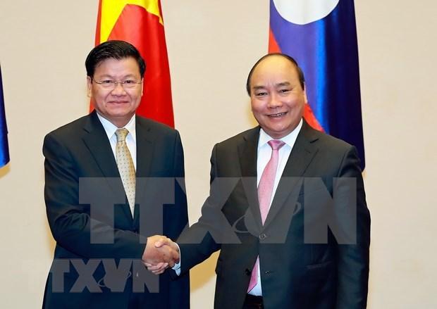 Relacion Vietnam-Laos se vuelve mas especial durante la pandemia de COVID-19 hinh anh 1