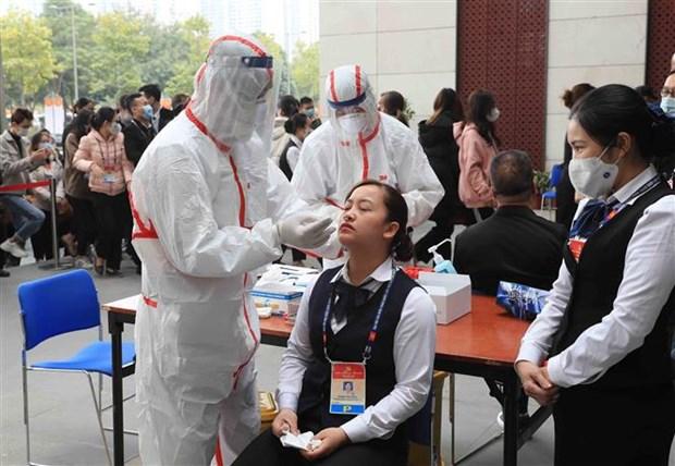 Realizan pruebas del COVID-19 a participantes en XIII Congreso partidista de Vietnam hinh anh 1
