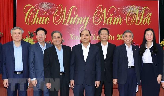 Premier vietnamita felicita a exdirigentes del Partido y Estado en ocasion del Tet hinh anh 1
