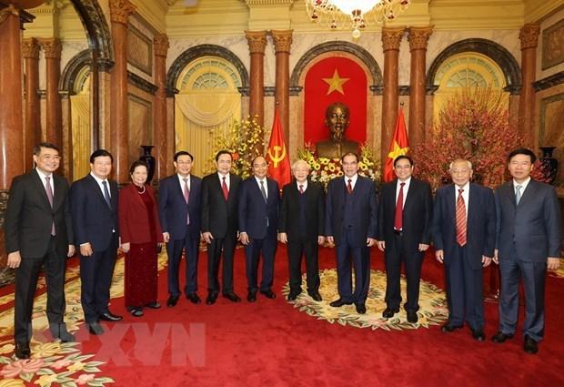 Maximo dirigente de Vietnam exhorta a construir un pais mas prospero y feliz con motivo del Ano Nuevo Lunar hinh anh 2